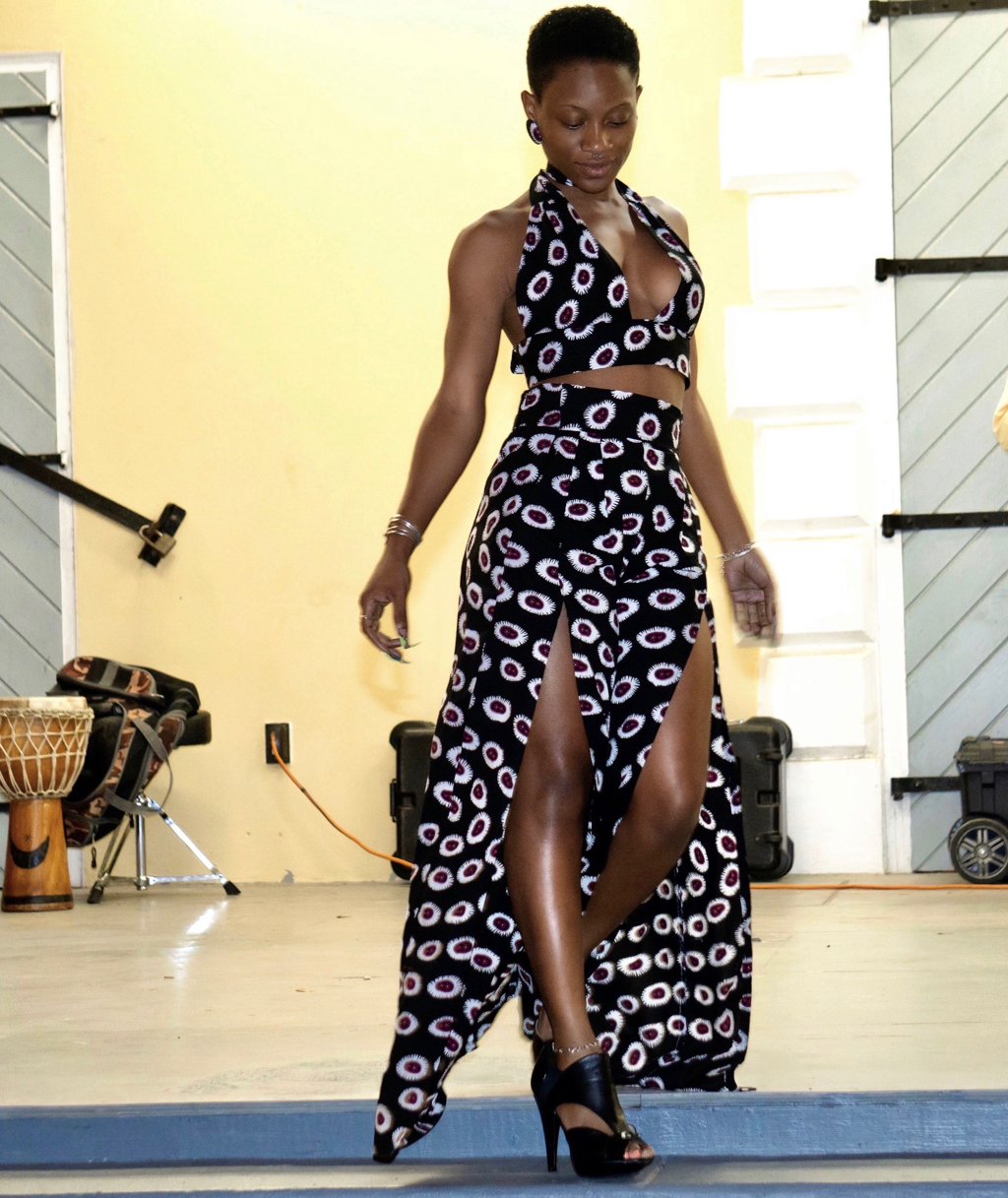 "Kezia ""Kizee"" Sylvester of Royal Modeling Agency, managed by Christopher Rivera, models a floor length African print original by Giana ""Regal"" Christopher, who is a self-taught seamstress, also works in madras, owns and operates Regal Fashions since 2012.. (Submitted photo)"