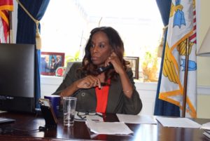 Delegate Stacey Plaskett (D-VI) on the phone in her Washington D.C. office speaking with reporters in March 2020. (File photo provided by Delegate Stacey Plaskett's office)