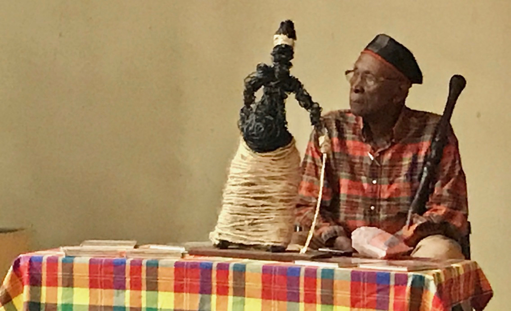 Author and poet Richard Schrader read his poem, 'I Sing of the Madras,' at Saturday's event. The poem spoke to the connection of the Virgin Islands as the many threads of the same cloth of the madras, binding us all through our history and culture. (Source photo by Elisa McKay)