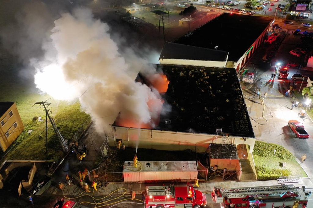An aerial photo captures the scene as firefighters battle the blaze that has burned through the roof. (Photo provided by V.I. Fire Services Director Daryl. A. George Sr.)