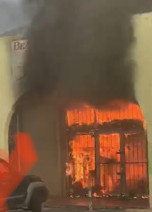 Flames engulf the bridal shop at the Wheatley Center. (Reader submitted photo)
