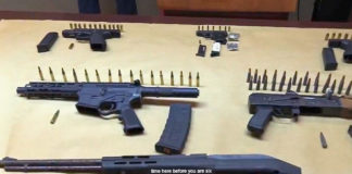 Pistols and assault rifles confiscated in Hospital Ground over the past week were on display during Tuesday's news briefing.