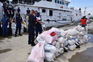 The crew of the Coast Guard Cutter William Trump offloads 1,100 pounds of marijuana, Wednesday, at Sector San Juan. (U.S. Coast Guard photo by Ricardo Castrodad)