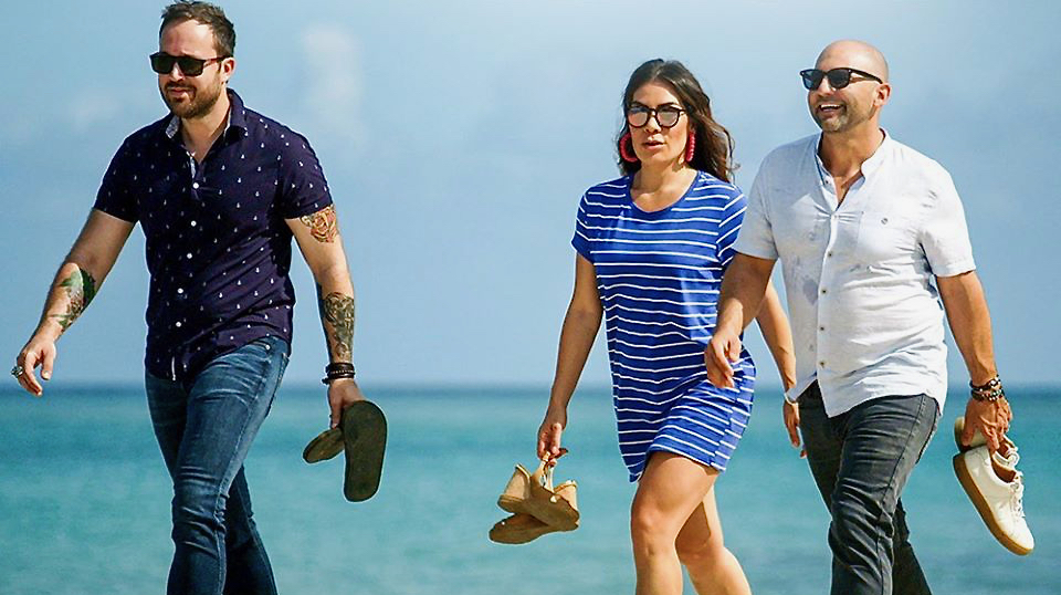 From left, 'Restaurants on the Edge' stars Dennis Prescott, Karin Bohn, and Nick Liberato walk across the Frederiksted beach. (Photo from Louie and Nachos Beach Bar Facebook page)