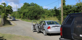 Police process two vehicles involved in a shooting in Estate Paradise. (VIPD photo)