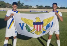 Konner and Karson Kendall hold up the Virgin Islands Flag at a recent CONCACAF Nations League game. (Photo provided by Konner Kendall)