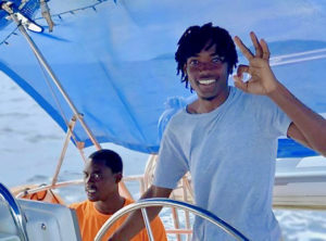 St. Thomas' Shamar Lewis takes the wheel during the 2019 VIPCA Marine Apprenticeship. (Photo provided by VIPCA Marina Apprenticeship)