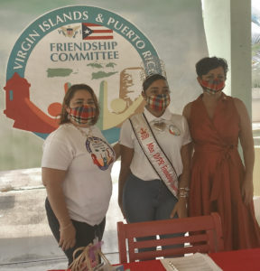 From left, Maria Colon-Clarke, Miss VI-PR Friendship 2019 Rosa-Leea Clarke, and DHS Commissioner Kimberly Causey-Gomez make a presentation to senior caregivers on Friday. (Source photo by Elisa McKay)