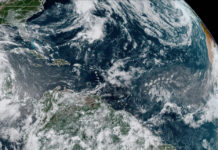 Monday morning's NOAA satellite photo shows clouds and rain over the Atlantic, but no sign of an organizing system on the first day of the 2020 Atlantic hurricae season. (NOAA photo)