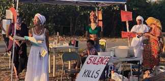 From left, Jennifer Fuentes, Diana Sragosa-Wison (known as Lady D), Zydmarie Sanes, Chenzira Davis-Kahina, Maria Stiles and others helped organize a vigil at the Lagoon Sunday night. (Source photo by Susan Ellis)