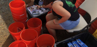 Storm Strong Program Graduate Amber LaPlace assembles hurricane preparedness kits to distribute to community members at the 2019 St. Thomas and St. John Agriculture Fair. (Photo by Kristin Wilson Grimes)
