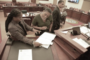 Sens. Janelle Serauw, Donna Frett-Gregory and Kurt Vialet during Friday's meeting. (Photo by Barry Leerdam, Legislature of the U.S. Virgin Islands)
