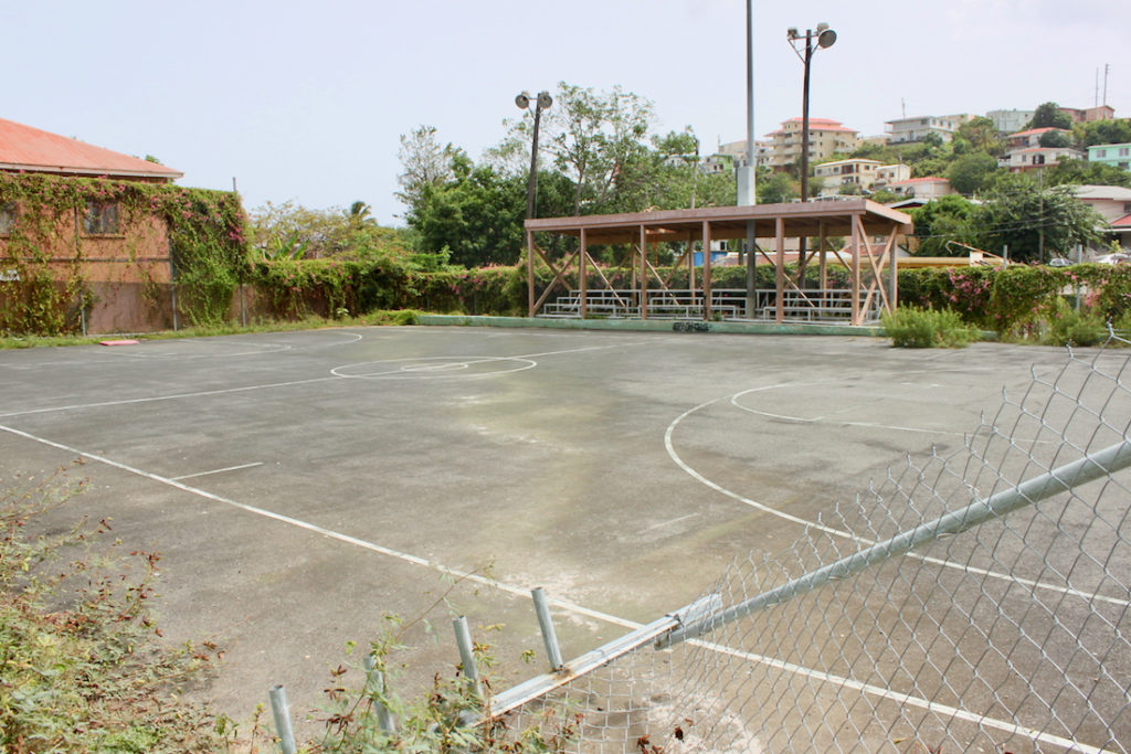 The basketball court in the Savan Playground and Park is devoid of lighting, backboards, and rims. (Source photo Bethaney Lee)